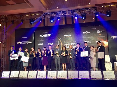 "Photo: Megaworld executives receiving this year's ""Best Developer"" award, along with eight other major awards and 17 highly commended citations—reportedly the most for any real estate company this year (Inquirer)"
